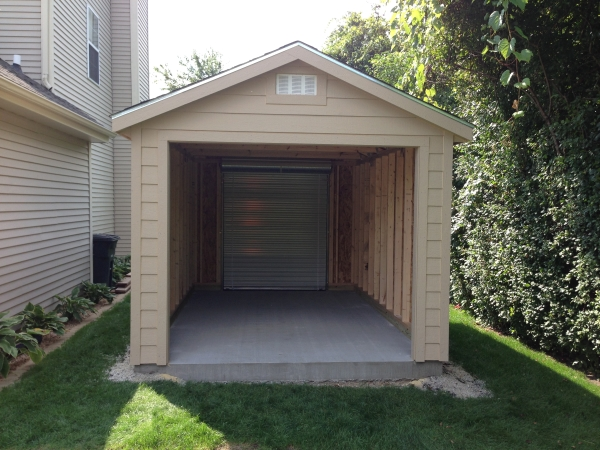 oerhead garage door on the front of the shed
