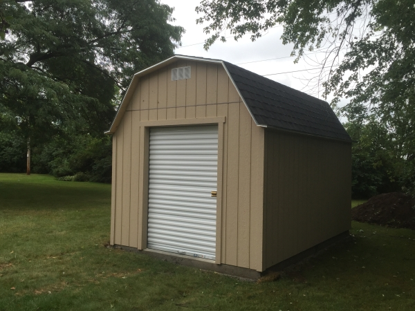 Barn roof sheds wisconsin storage shed builders for 12x14 roll up door