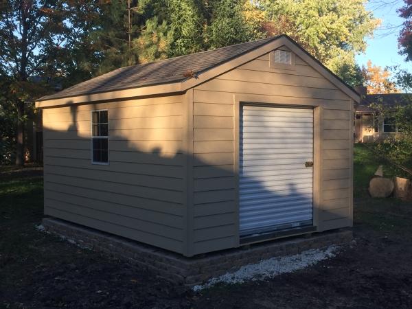 garage with lap siding gable roof sheds milwaukee custom storage shed builders mainus